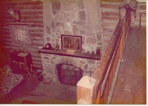 Two-story rock fireplace viewed from the balcony.